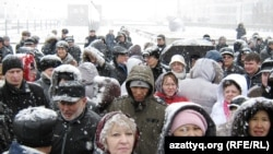 Participants march in snowy Astana today to protest the upcoming presidential election.