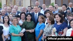 Azerbaijani President Ilham Aliyev meets with journalists at the inauguration ceremony for the new apartment building in Baku.