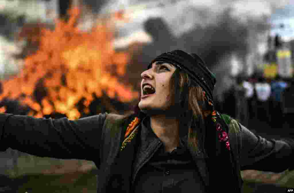 A Kurdish woman dances in front of a fire as Turkish Kurds gather for Norouz celebrations for the new year in Diyarbakir. (AFP/Bulent Kilic)