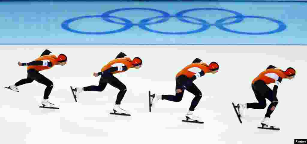 A multiesposure image captures the Netherlands' Jan Blokhuijsen in action during the men's 5,000 meters speed skating race.