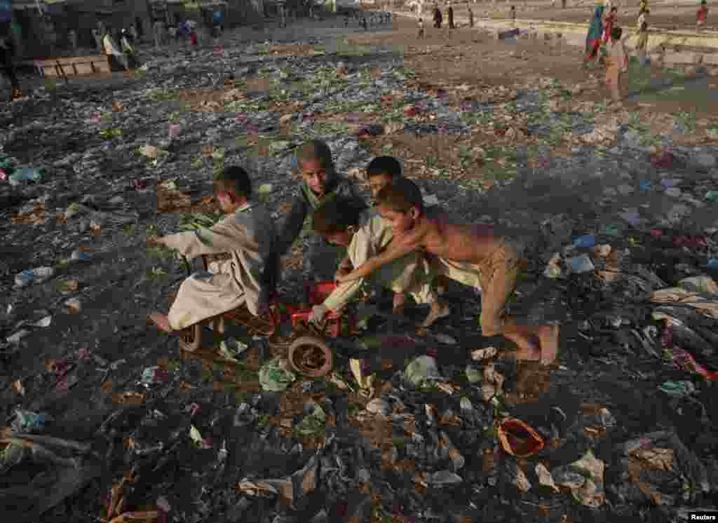 Children play in a slum area of Karachi, Pakistan.