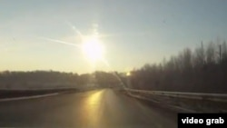 A still from a dashcam video from Chelyabinsk as the meteor streaks over the highway in February.