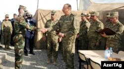 Azerbaijani President Ilham Aliyev (center) visits a military unit in Agdam, on the front line of the battle over Armenian-occupied Nagorno-Karabakh, on August 6.