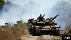 Pro-Russian separatists withdraw tanks from the front line in the Luhansk region in October -- have they since returned, as some reports suggest?