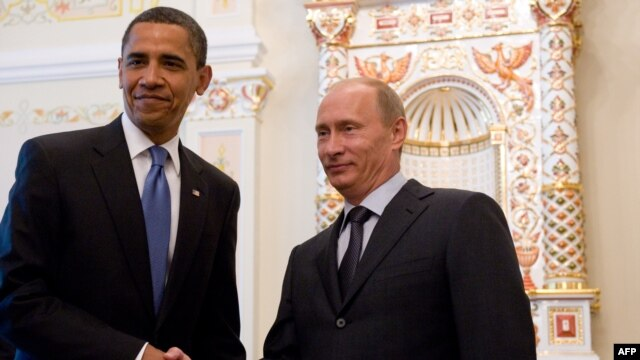 Freedom House has urged U.S. President Barack Obama (left) to 'think twice' before traveling to Russia to meet President Vladimir Putin before September's G20 summit.