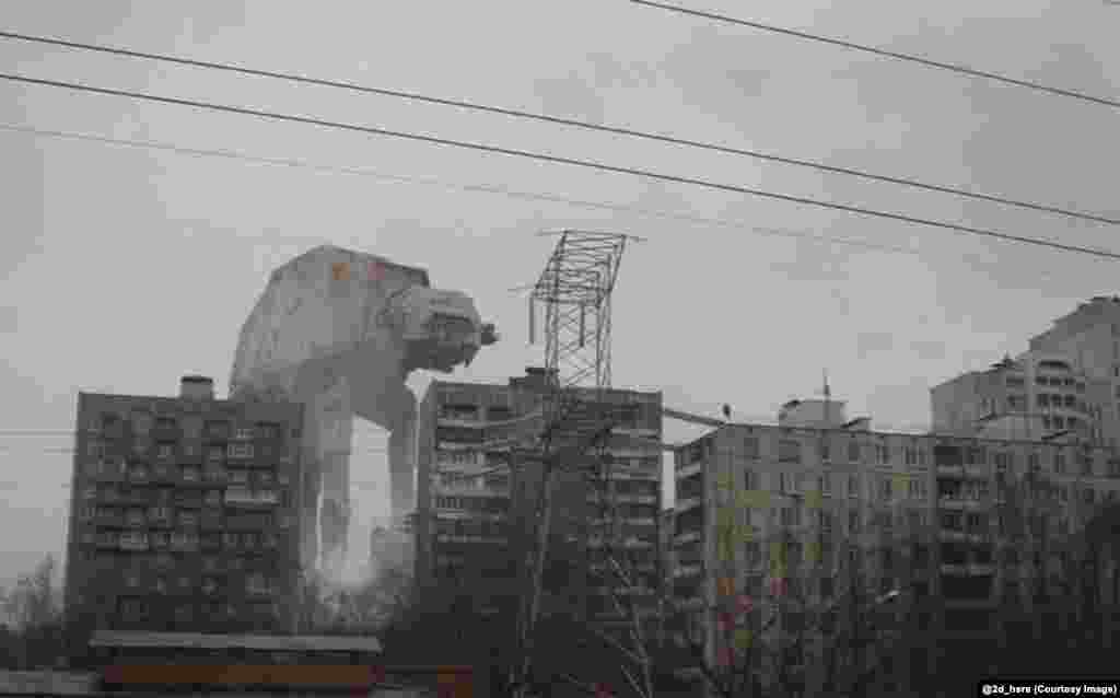 An AT-AT Walker from Star Wars bearing down on Russian apartment buildings.