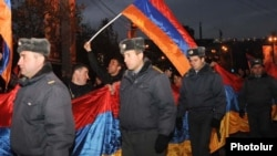 Armenia -- Riot police escort thousands of opposition supporters marching through central Yerevan, 18Feb2011.