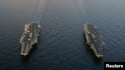 "The Nimitz-class U.S. aircraft carriers ""USS Abraham Lincoln"" and ""USS John C. Stennis"" are seen in the Arabian Sea in January."