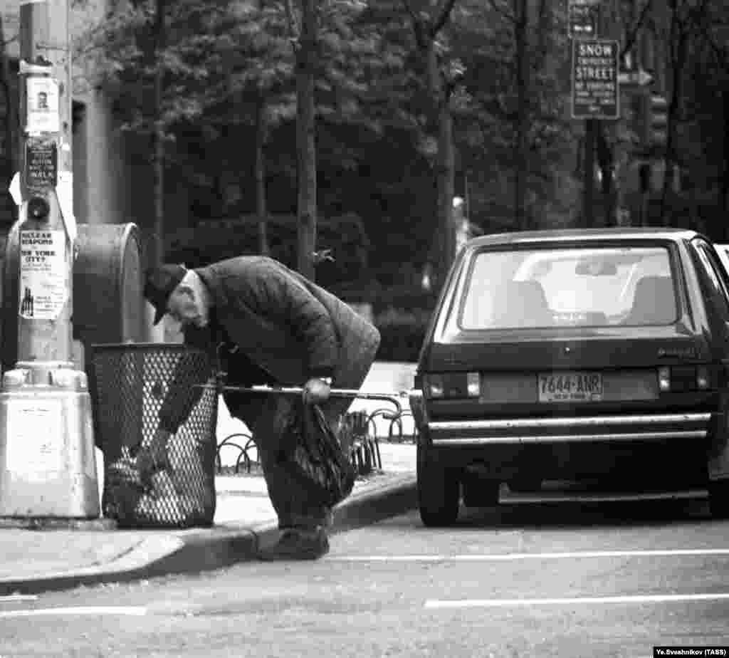 This 1985 image of a man picking through a trash can in New York is one of many pictures in the archive focusing on American poverty.