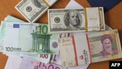 Еуро, АҚШ доллары және Иран риалы. (Көрнекі сурет)