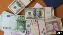 Dollarë, euro dhe valuta iraniane, rial