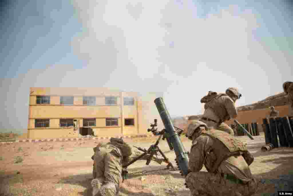 "U.S. Marines pop a mortar towards an IS target in eastern Syria in October 2018. U.S. forces have also launched ""kill or capture"" missions targeting prominent IS leaders."