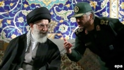Iranian Supreme leader Ayatollah Ali Khamenei (left) listens to Islamic Revolutionary Guards Corps (IRGC) commander Mohammad Ali Jafari during a ceremony in Tehran in November.