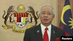 Малайзия премьер-министрі Наджиб Разак телеарнадан сөйлеп тұр. Путраджайа, 3 сәуір 2013 жыл.