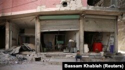 A destroyed shop in the eastern Damascus suburb of Ghouta on July 19.