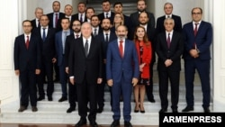 Armenia - Prime Minister Nikol Pashinian and members of his government pose for a photograph with President Armen Sarkissian after being sworn in at the presidential palace in Yerevan, 21 May 2018.