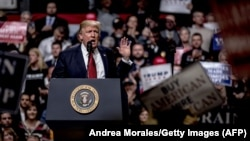 US -- NASHVILLE, TN - MARCH 15: President Donald Trump speaks at a rally on March 15, 2017 in Nashville, Tennessee. During his speech Trump promised to repeal and replace Obamacare and also criticized the decision by a federal judge in Hawaii that halted