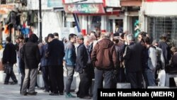 People without work on a street in Hamadan, Iran, not respecting social distancing rules. April 13, 2020