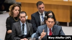 Israel's Ambassador to the United Nations Danny Danon, right, is joined by Oran Almog, second from left, during a Security Council meeting on the situation in the Middle East, including the Palestinian question, Tuesday, July 25, 2017 at United Nations he