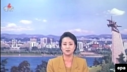 A newsreader of North Korea's official KCNA-TV reports the statement by the Foreign Ministry rejecting a UN Security Council statement condemning the North's recent rocket launch.