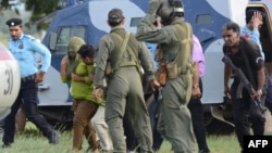 Pakistani security personnel move Rimsha Masih (second from left) to a helicopter after her release from jail in Rawalpindi on September 8.