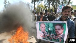 Supporters of former Prime Minister Nawaz Sharif protest against the Supreme Court verdict in Islamabad.