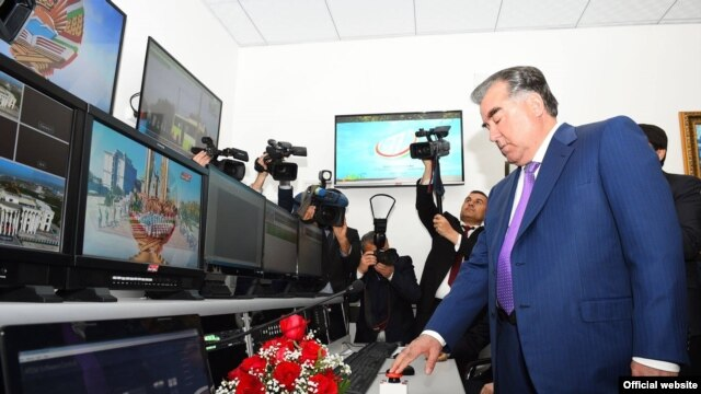 Tajik President Emomali Rahmon helps launch two new Tajik TV channels on March 1.