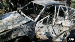 Фотография сожженной машины, которую официально распространяет сирийское агентство SANA