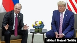 Russian President Vladimir Putin (left) and U.S. President Donald Trump hold a meeting on the sidelines of the G20 summit in Osaka, Japan, on June 28, 2019.