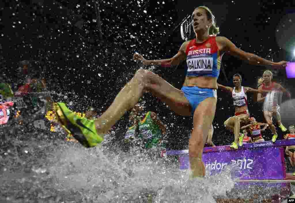 Russia's Gulnara Galkina on her way to winning the women's 3000-meter steeplechase final at the Olympics on August 6.