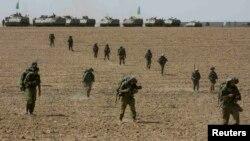 Израильские военные в районе сектора Газа, 12 июля 2014 года.