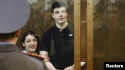 Convicted killers Yevgeniya Khasis (left) and Nikita Tikhonov during their sentencing in a courtroom in Moscow in May 2011.