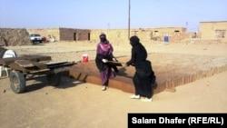 نساء في احد معامل الطابوق في ميسان