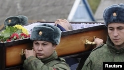 Russian servicemen carry the coffin of Vadim Kostenko at his funeral in the village of Grechnaya Balka on October 28.