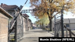 "The infamous entrance to the former Nazi concentration camp Auschwitz-Birkenau, with the phrase ""Arbeit macht frei"" (""Work makes you free"") above the gate."