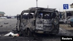 Daghestan -- A view shows a burnt vehicle near a damaged traffic checkpoint near the town of Derbent, February 15, 2016