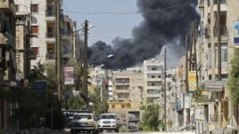 Syria -- Smoke rises after a Syrian Air Force fighter jet launched missiles at El Edaa district in northwestern city of Aleppo, 05Sep2012