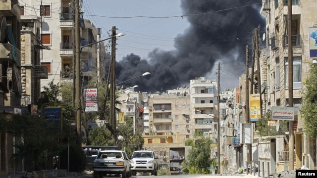 Smoke rises after a Syrian Air Force fighter jet launched missiles in the northwestern city of Aleppo on September 5.