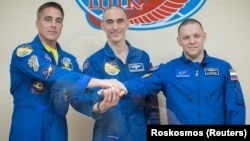 Chris Cassidy of NASA (left to right), Anatoly Ivanishin and Ivan Vagner of Roskosmos pose for a picture ahead of their mission to the International Space Station on April 8.