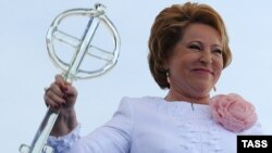 St. Petersburg's governor Valentina Matviyenko with a giant glass key at the opening ceremony of new cruise passenger terminal in St. Petersburg on May 27.