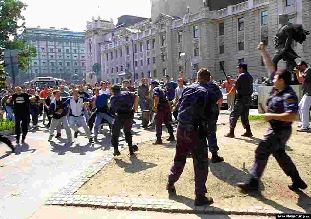 Serbian police clash with several hundred nationalist thugs who had thrown stones and attacked gay activists in Belgrade on June 30, 2001.