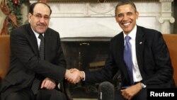 أوباما مستقبلاً المالكي في البيت الأبيض بواشنطن في 12 كانون أول 2011.