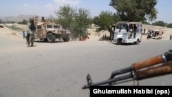 Afghan security forces stop vehicles at a checkpoint in Jalalabad.