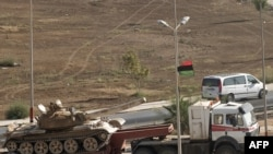 Повстанцы перемещают военную технику на запад страны