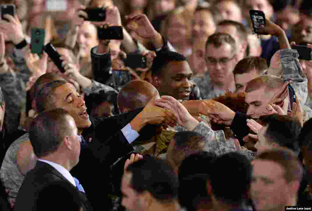 The president thanks troops for their service at a military base in Wrightstown, New Jersey, on December 15, 2014. The visit came shortly before Obama declared the end of the U.S. combat mission in Afghanistan on December 28.