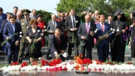 Armenia - Prime Minister Hovik Abrahamian (C) and other senior officials lay flowers at the World War Two memorial in Yerevan, 9May2014.