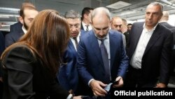 Armenia -- Prime Minister Nikol Pashinian (C) visits new textile factories opened by businessman Samvel Aleksanian (R), Yerevan, November 1, 2019.