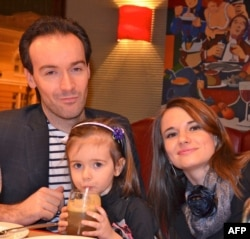 Yoann Barbereau with his then-wife, Darya Nikolenko, and their daugher Eloise in a photo taken on December 31, 2012