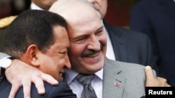 Venezuelan President Hugo Chavez (left) and his Belarusian counterpart, Alyaksandr Lukashenka, embrace at Miraflores Palace in Caracas.