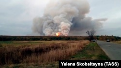 Smoke and fire are seen at the stricken ammunition depot in Russia's western Ryazan region.